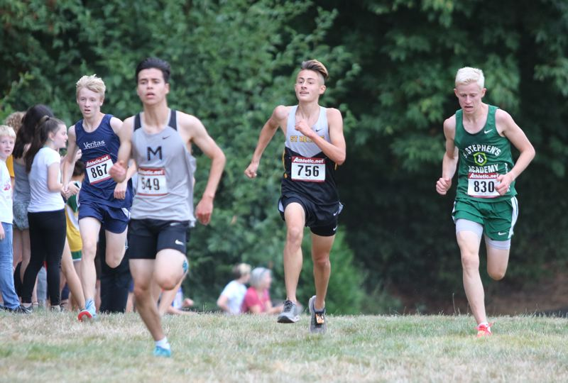 PAMPLIN MEDIA: JIM BESEDA - St. Helens junior Waylon Nichols (756) runs alongside Veritas' Cam McChesney (867) and St. Stephens' Seth Bergerson (830) as they try to chase down Mountainside's Allen Hodovan (549) as they near the finish of the Aug. 30 Nike Bill Chapman Invitational at Rood Bridge Park in Hillsboro.