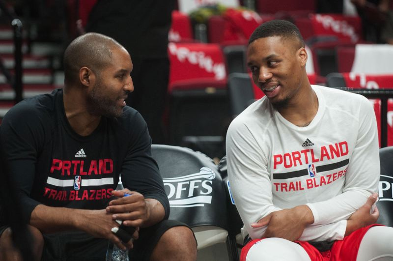TRIBUNE FILE PHOTO: JOSH KULLA - Trail Blazers assistant coach David Vanterpool (left), chatting with Portland star guard Damian Lillard before a game at Moda Center, is gaining recognition in basketball circles as an up-and-coming head coach candidate.
