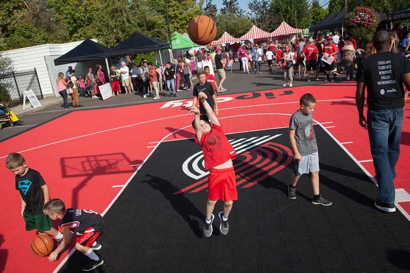 PHOTO COURTESY OF PORTLAND TRAIL BLAZERS - Kids join an on-court Youth Basketball Activation during a 2017 Rip City Rally. The event comes to Prineville Sept. 12.