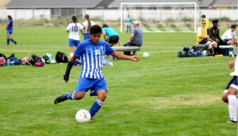 STEELE HAUGEN - Cesar Aguirre passes the ball toward the middle of the field during their 9-1 win over the Cowboys.