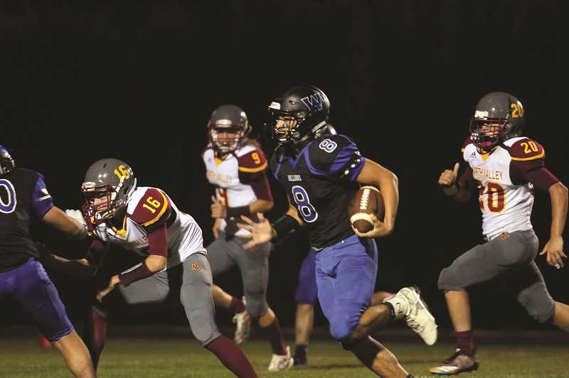 PHIL HAWKINS - Senior Nate Corpuz traded time with Veliz at quarterback, catching a 31-yard touchdown pass in the fourth quarter for the Bulldogs' final score of the game.