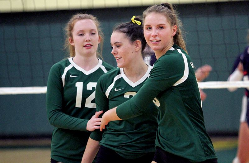 TIDINGS FILE PHOTO - West Linn's (from left) Isabella Forster, Hannah Hashbarger and Makayla Long hope to lead the Lions back to the Class 6A state tournament after a third-place finish in 2017.