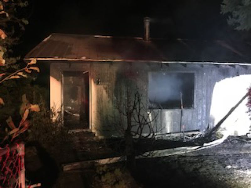 PHOTO COURTESY OF SCAPPOOSE FIRE DISTRICT - Scappoose Fire District crews responded to a house fire on Elm Street that sent one person to the hospital on Monday, Sept. 3.