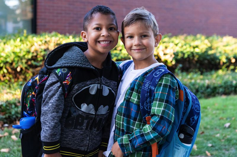 STAFF PHOTO: CHRISTOPHER OERTELL - Best friends Anakin Murray and Finn Rumore pose for a photo before beginning first grade at Orenco Elementary School on Tuesday, Sept. 4.
