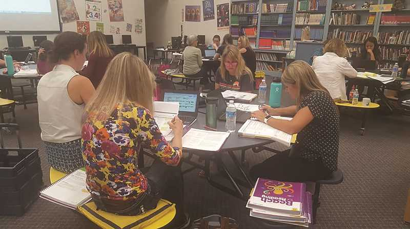 CREIGHTON HELMS - Gervais Elementary School teachers returned to school early to take a look at the school's new English language arts curriculum.