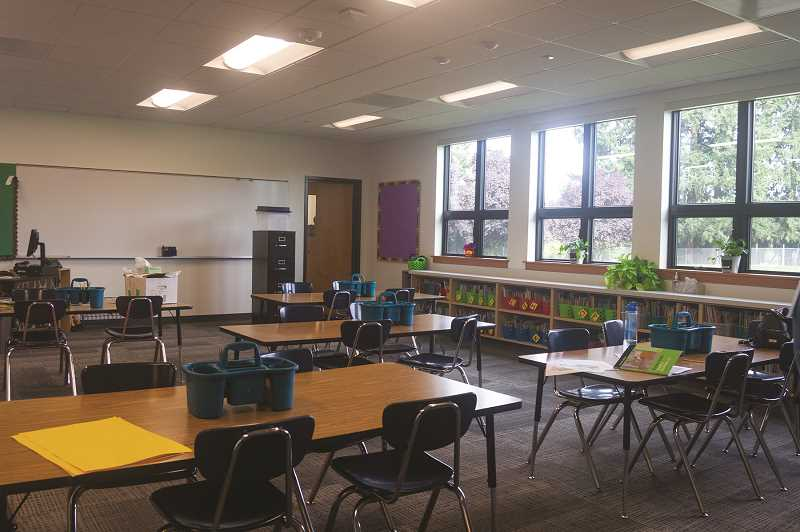 PATRICK EVANS - New classroms at Washington Elementary have modern amenities including several white boards in each room and flatscreen TVs to aid instruction.