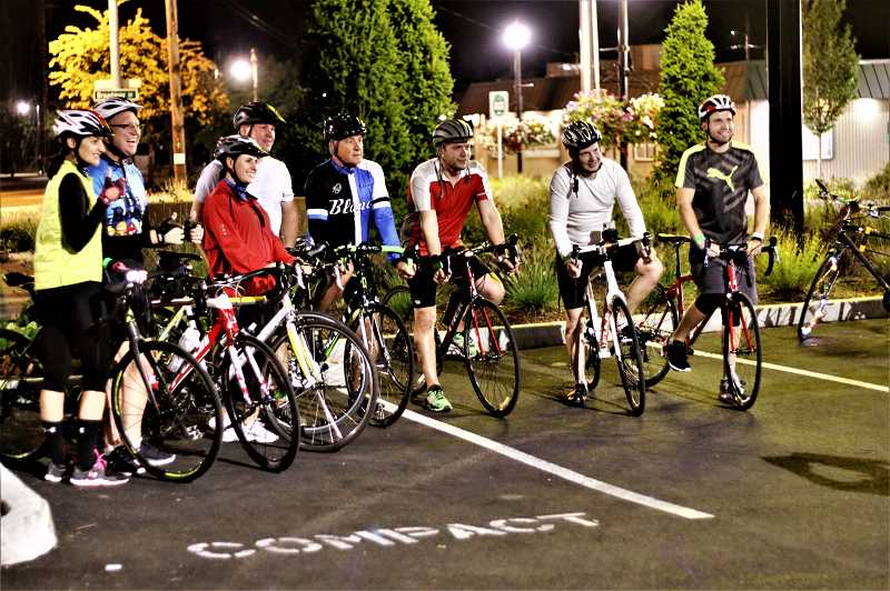 CONTRIBUTED PHOTO: LARRY CUTLER AND LOREN NIBBE - A group of cyclists are all smiles during the Faraday Moonlight Ride on Saturday, Aug. 26.