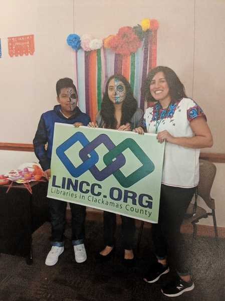 CONTRIBUTED PHOTO - Many attendees of last year's Day of the Dead celebration at the Estacada Public Library had their faces painted.