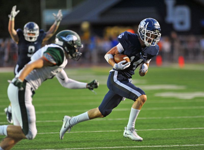 REVIEW PHOTO: VERN UYETAKE - Lake Oswego receiver Joe Hutson heads to the end zone for one of his two TD catches during the Lakers' 48-14 win over West Salem at Lake Oswego High School on Friday.