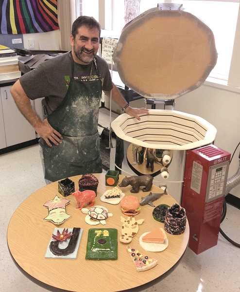 COURTESY PHOTO: CRAIG CERVANTES - Colton School District teacher Craig Cervantes with the new kiln and some of the CMS student clay pieces.