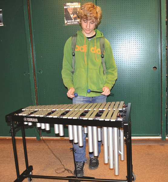 PIONEER PHOTO: CINDY FAMA - Christian Weinberger plays the new vibraphone that the Colton School District recently purchased with donated funds.
