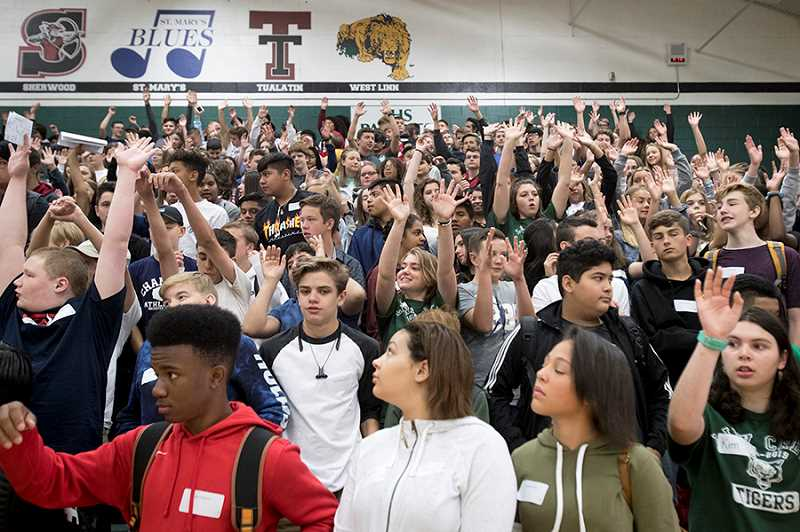 TIMES PHOTO: JAIME VALDEZ - Teachers and administrators greeted an enthusiastic group of freshmen Tuesday at Tigard High School.