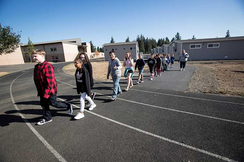 TIMES PHOTO: JAIME VALDEZ - Fifth-graders in Lisa Johnsons class at Templeton Elementary School take a short trip to visit the schools playground area Tuesday.