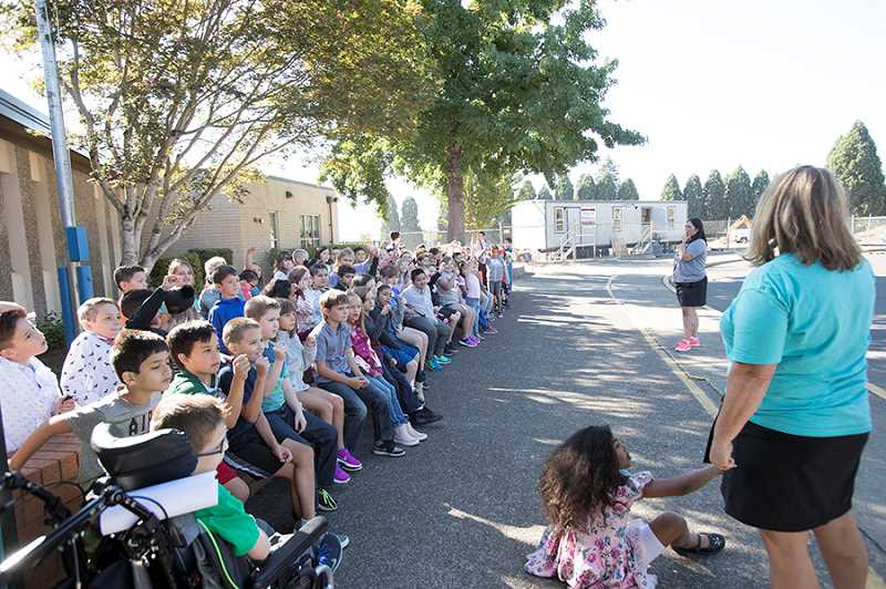 TIMES PHOTO: JAIME VALDEZ - Teachers and administrators get under students oriented to their new school surroundings Tuesday. Plans are to have the rebuilt Templeton Elementary School and running in Fall 2019.