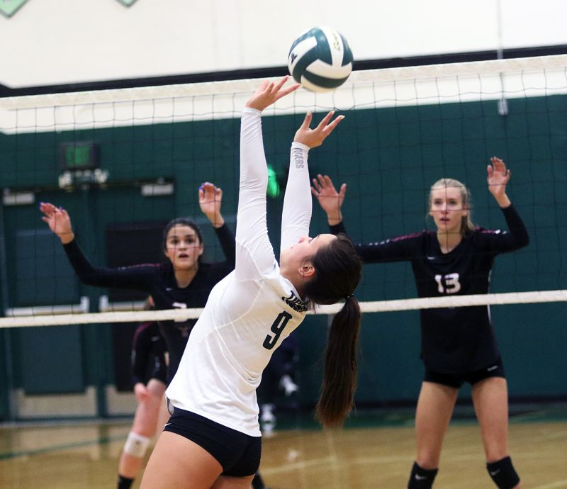 TIMES FILE PHOTO: DAN BROOD - Senior Avery Kim returns at setter for the Tigard High School volleyball team this year.