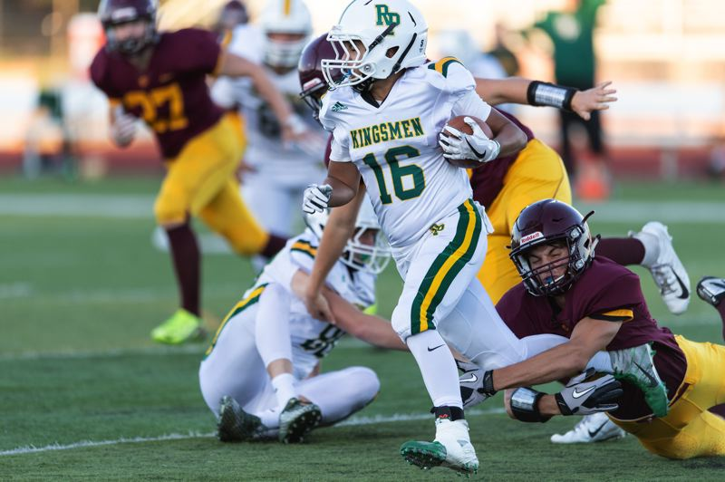 PAMPLIN MEDIA: CHRIS OERTELL - Putnam's Caleb Tovey (16) had 12 carries for a game-high 75 yards rushing and scored on runs of 5 and 4 yards during Friday's season-opening 33-13 loss at Forest Grove.
