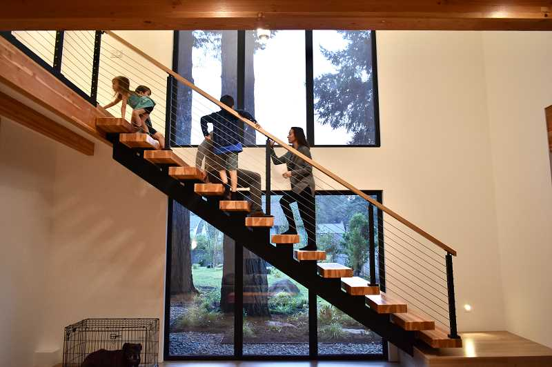 REVIEW PHOTO: LUCY KLEINER - When the Antonini family first moved in to their zero-energy home in Lake Oswego, the children feared the open staircase. But it's no longer a scary feat to climb the stairs that connect the children's bedrooms to the main floor.