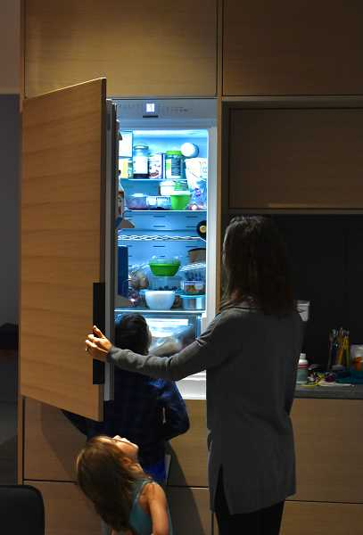 REVIEW PHOTO: LUCY KLEINER - Healthy living goes beyond a healthy building. The Antoninis purchased a small refrigerator to encourage them to eat fresh foods and keep them from freezing their meals.