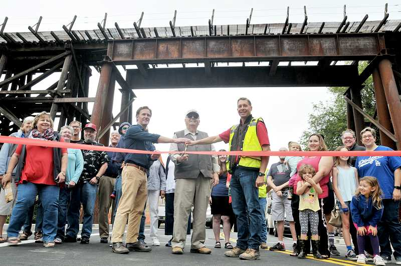 GARY ALLEN - Newberg Mayor Bob Andrews (center) led the ribbon-cutting ceremony Friday morning, officially opening Villa Road for traffic after months of closure.