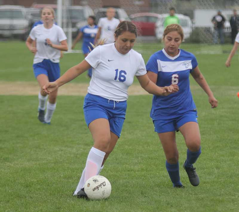 STEELE HAUGEN/MADRAS PIONEER - Marlen Ceja Prado controls the ball during the second half of the Cowgirls' match at Madras Thursday afternoon. The Cowgirls fell behind early but played the White Buffalos even in the second half of their 5-2 loss. Crook County is back in action on Tuesday, Sept. 4, when they host Dallas in a 4:30 p.m. match.