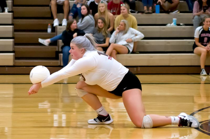 PHOTO COURTESY OF MIKE JULIANA - Tualatin senior Addy Crawford keeps the ball off the court durng the Timberwolves four-set victory over Tigard on Tuesday.