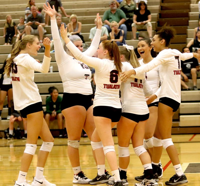 TIIMES PHOTO: DAN BROOD - Members of the Tualatin volleyball team celebrate following their victory against rival Tigard in a Three Rivers League match on Tuesday.