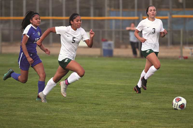 PHIL HAWKINS - North Marion senior Mar Verastegui sprints forward to deliver the ball into the back of the net for one of her four goals in last week's 8-1 win over Woodburn.