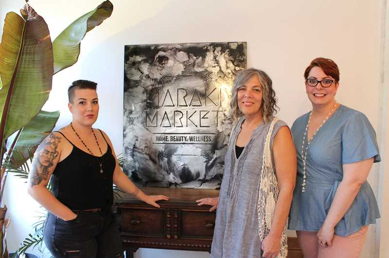 STAFF PHOTO: JANAE EASLON - Maraki Market's hair stylist and part owner Katheryn Hutt (left), her mother Debbie Schaffner (center) and fellow team member Kelsey Trostle (right) have worked together to open Maraki Market this summer on Forest Grove's Main St.