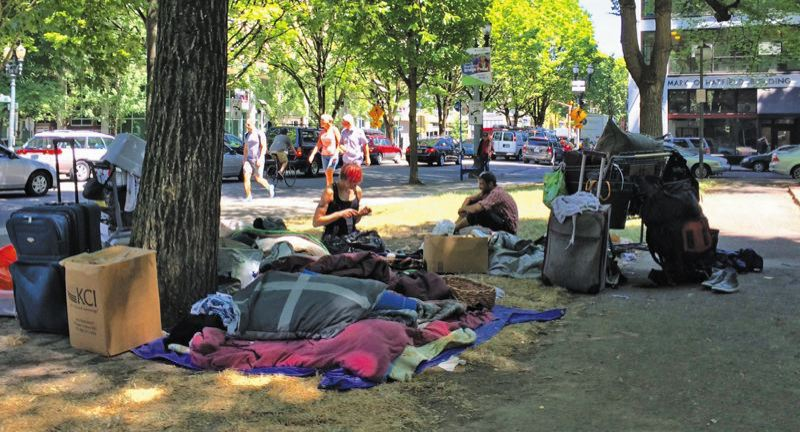 FILE PHOTO - Homeless people in a downtown park.