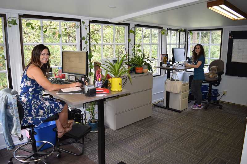 REVIEW PHOTO: ANTHONY MACUK - Supervisor Kelleigh Brown and Outdoor Coordinator Rikki Fisher settle in to their new offices on the second floor of Chirst Church Episcopal Parish.