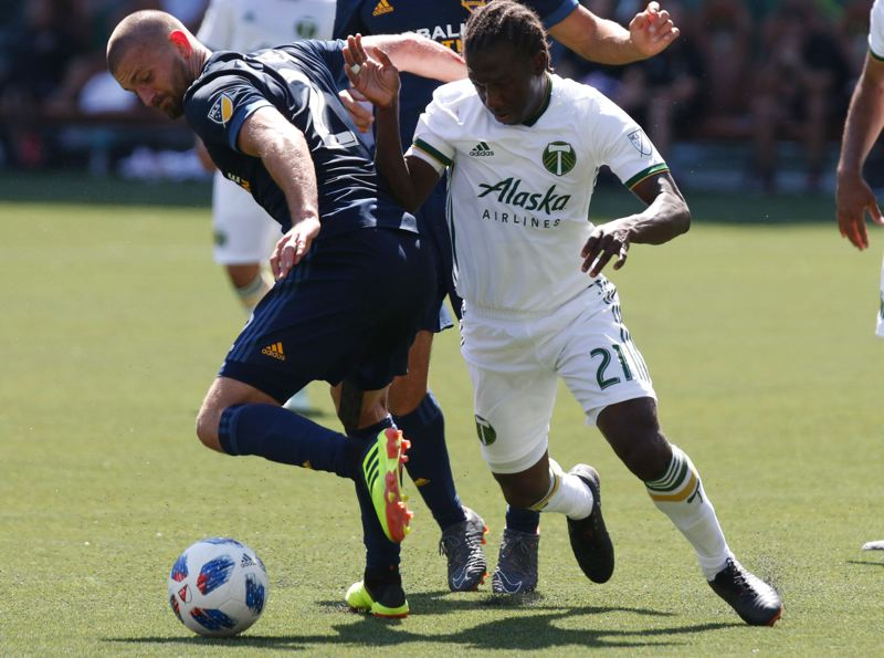 TRIBUNE FILE PHOTO: JONATHAN HOUSE - Pesky Diego Chara (right) will be one of several well-rested Portland Timbers ready to go Saturday at home against Colorado.