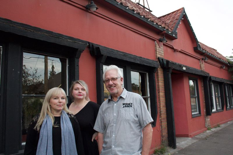 PAMPLIN MEDIA GROUP: STEPHANIE BASALYGA - Tacee Webb, from left, Heidi Lawler and Stuart Ramsay are beginning renovations on a building at the corner of Southeast 41st Avenue and Holgate that previously served as the home of Ye Olde Towne Crier. When work is completed, the building will feature a restaurant and lounge as well as a coffee shop.