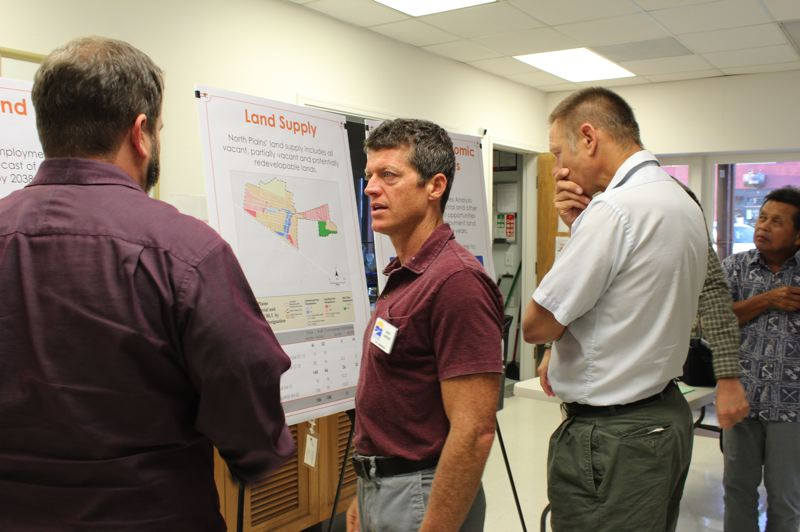 STAFF PHOTO: OLIVIA SINGER - North Plains City Manager Andy Varner spoke with community members during the open house Tuesday, Sep. 6, about what the projected growth could mean for the city.