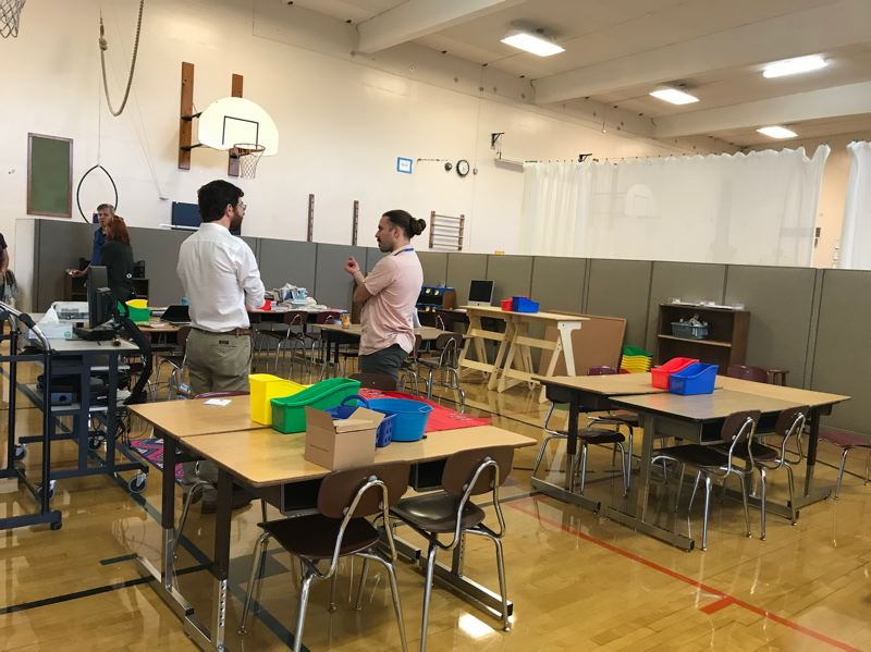 COURTESY PHOTO: SENNA PINNEY - At an open house, a teacher and parent speak in a classroom set up in the Bridger K-8 School gymnasium.