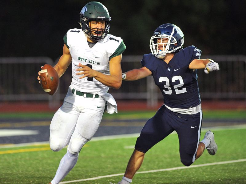 REVIEW PHOTO: VERN UYETAKE - Lake Oswego senior linebacker Gabe DeVille (right) and the Lakers will be back in action this week when they visit Jesuit at 7 p.m. Friday.