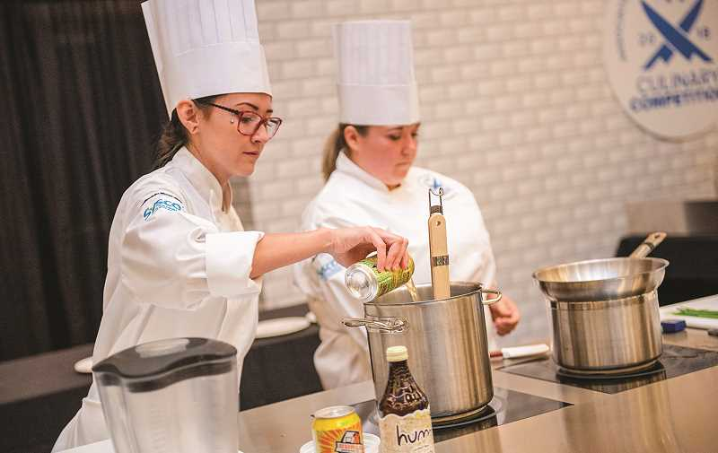 PHOTO COURTESY OF AMY COPPERSMITH - St. Charles Prineville chefs Cameryn Turner, left, and Stephanie Gates competed in the Association for Healthcare Foodservice's Annual Culinary Competition in Minneapolis, Minnesota, on Aug. 22.