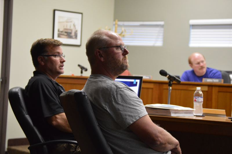 SPOTLIGHT PHOTO: COURTNEY VAUGHN - Kevin Turner and Dave Sukau present the latest version of a wastewater treatment plan to Scappoose city councilors Tuesday, Sept. 4.