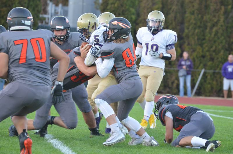 SPOTLIGHT PHOTO: JOHN BREWINGTON - The Scappoose defense was stingy in last week's season opener, won by the Indians, 27-0, over Astoria.