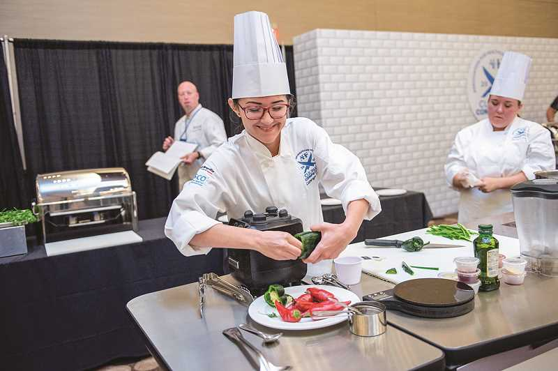 PHOTOS COURTESY OF AMY COPPERSMITH  - St. Charles Prineville chefs Cameryn Turner prepares a dish with peppers.
