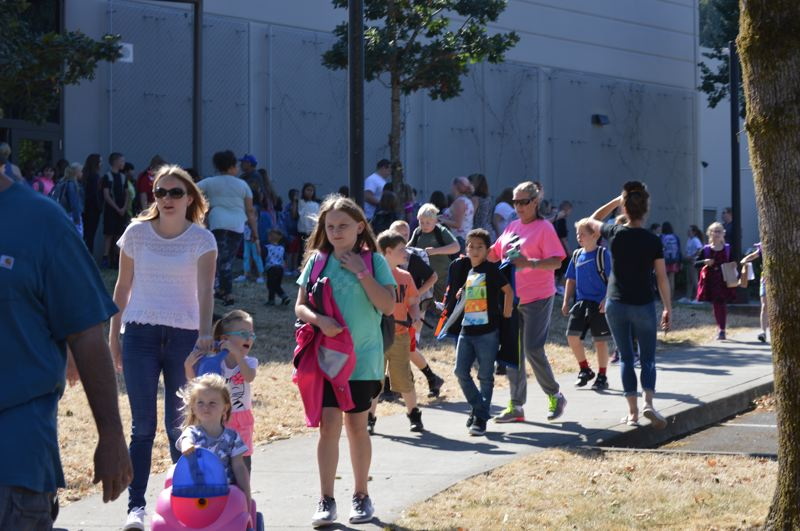SPOTLIGHT PHOTO: NICOLE THILL-PACHECO - Students at Otto Petersen Elementary School head for the bus or parent pickup after the first day of school, Tuesday, Sept. 4. Students in the Scappoose and St. Helens school districts returned to school for the 2018-19 school year this week.