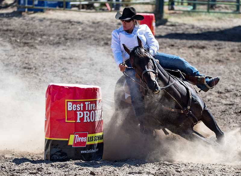 LON AUSTIN/CENTRAL OREGONIAN - Lisa McLean makes a winning run in barrel racing. McLean finished with a time of 16.74, far ahead of her nearest competitor.