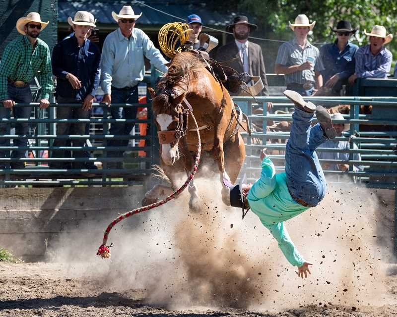LON AUSTIN/CENTRAL OREGONIAN - Levi Durban is bucked off his horse in the ranch bronc riding event.