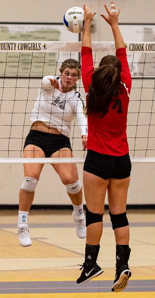 LON AUSTIN/CENTRAL OREGONIAN - Kenna Woodward hits a kill off of the block of Sophia Courville of Madras to end the match. The Cowgirls won the match three games to zero to remain undefeated on the year.