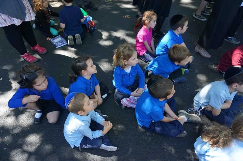REVIEW PHOTO: CLAIRE HOLLEY - Young children listen (somewhat intently) to the various speakers at a celebration of the opening of the Maayan Torah Day School in Lake Oswego.