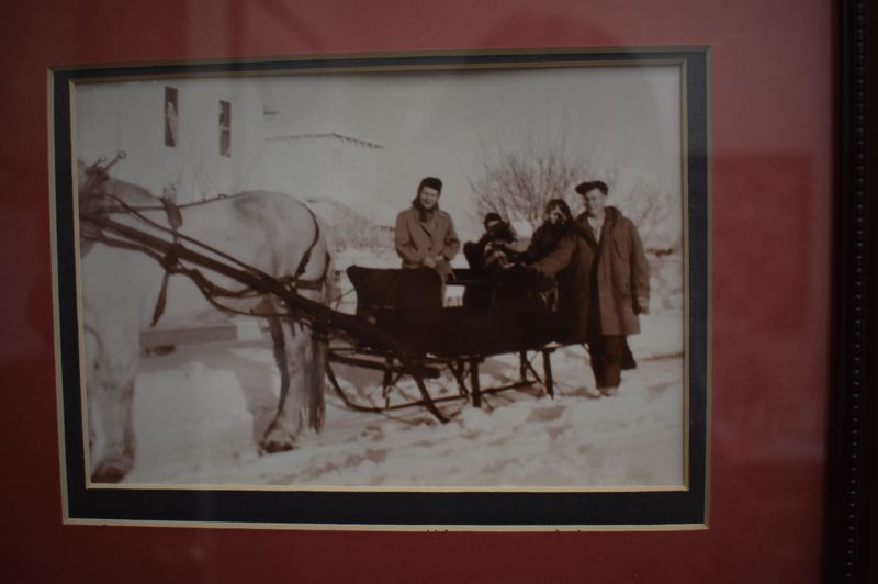OUTLOOK PHOTO: TERESA CARSON - This is the Eklund family back in the day with their sleigh, which now hangs high in the lobby of the restaurant at Cleveland and Burnside.