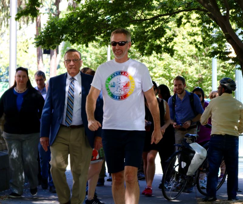 TRIBUNE PHOTO: ZANE SPARLING - Mayor Ted Wheeler saunters along Southwest Columbia Street in downtown Portland during the kick-off for STEPtember, a movement sponsored by Oregon Walks.