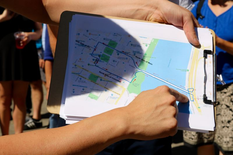TRIBUNE PHOTO: ZANE SPARLING - Izzy Armenta with Oregon Walks displays a clipboard with a map of the roughly 1.4-mile route on Friday, Sept. 7 in downtown Portland.