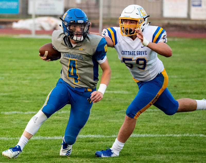 LON AUSTIN/CENTRAL OREGONIAN - Brody Connell attempts to escape from Cottage Grove linebacker Trace Nelson