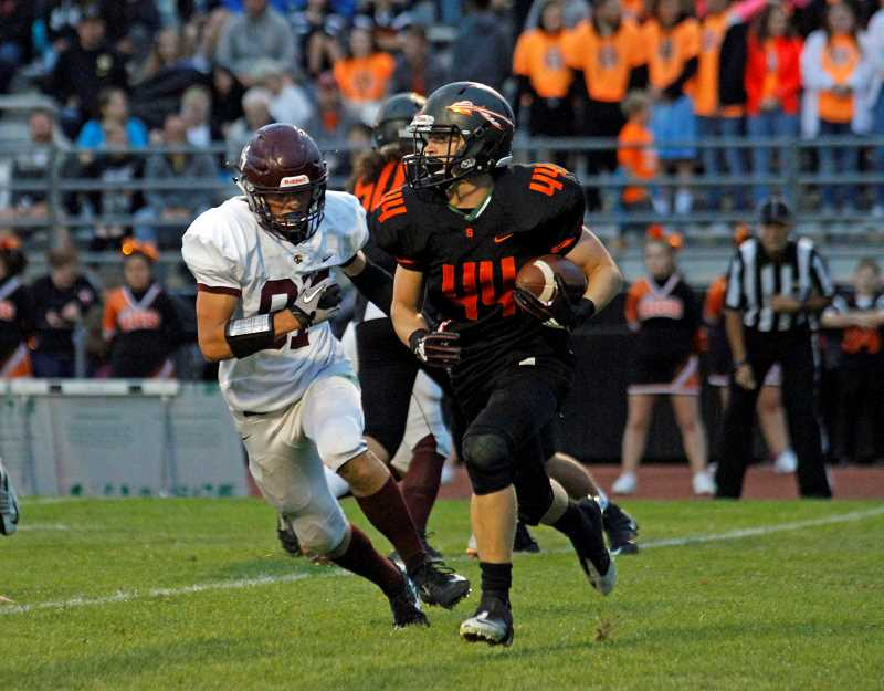 STAFF PHOTO: WADE EVANSON - Scappoose's Connor McNabb carries the ball during the Indians' game against Forest Grove, Sept. 7, at Scappoose High School.