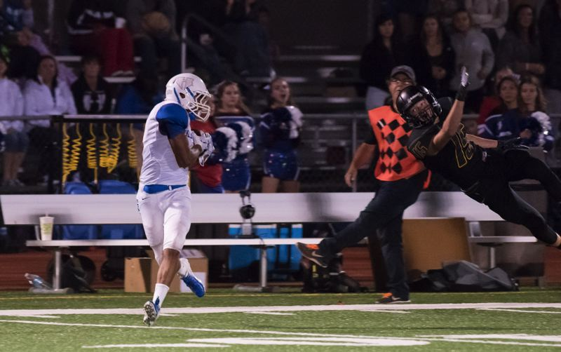 COURTESY: JEREMY DUECK - Elian Lopez-Arana of Hillsboro hauls in a pass during Friday night's game at St. Helens.